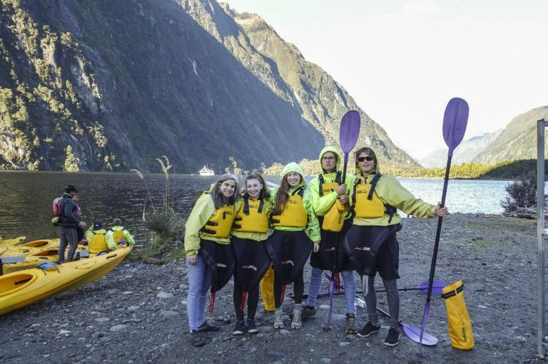 Pauline, with daughters and friends, getting ready to kayak in the Milford Sound, New Zealand. Courtesy of Pauline Frommer.